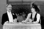 Adolphe Menjou and Edna Purviance. Still courtesy of Photofest.